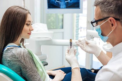 dentist explaining dental implant components